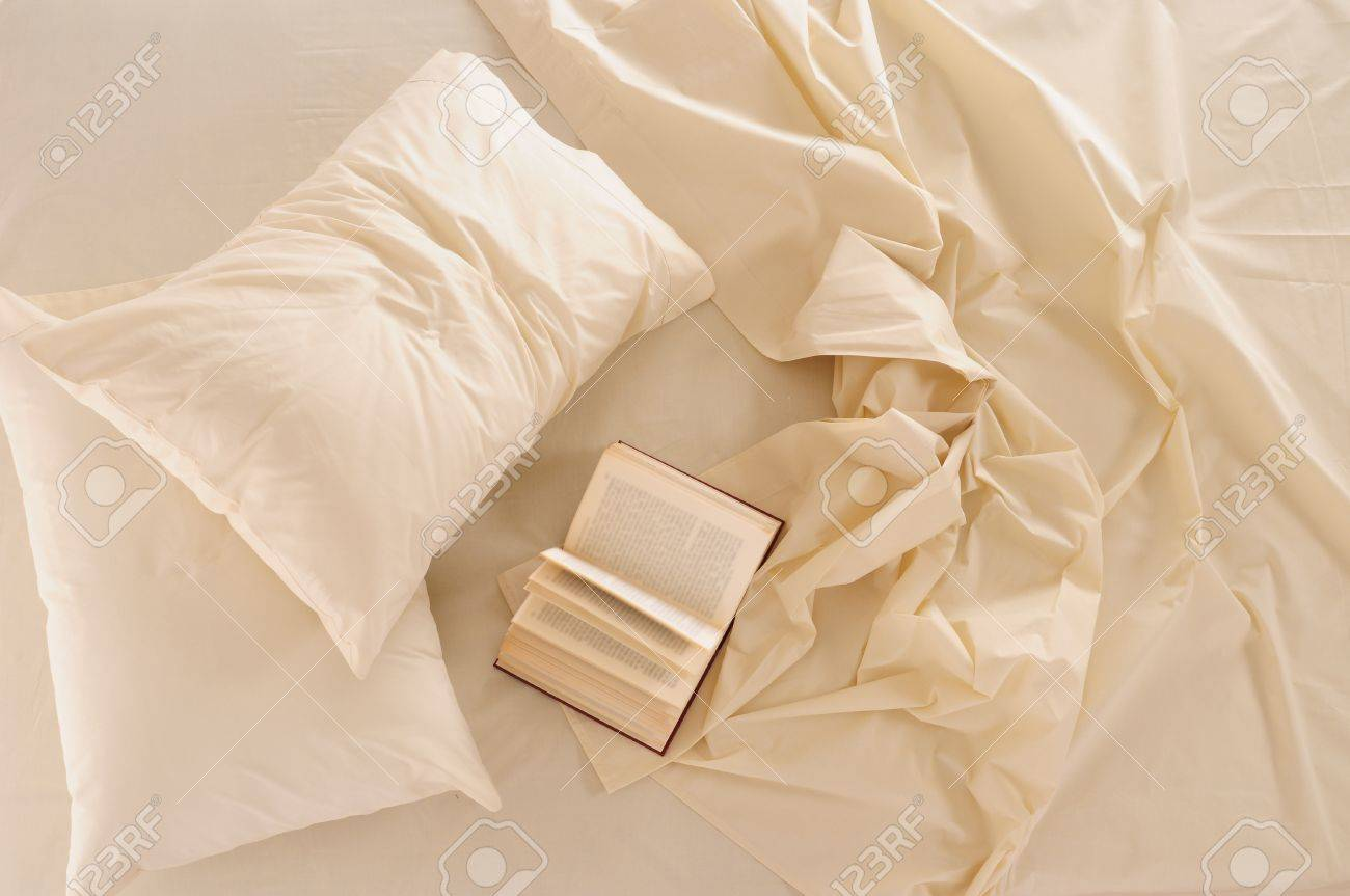 Book on messy bed. Stock Photo - 8664140
