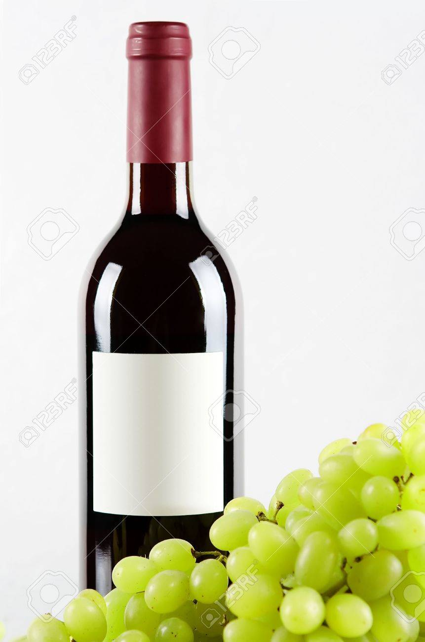 Bottle of red wine and green grapes in front isolated on white background Stock Photo - 5743917