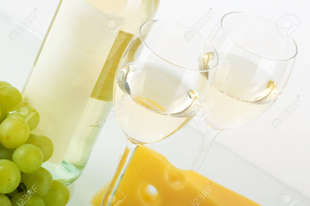Bottle of white wine, wine glasses, grape and cheese Stock Photo - 6034380