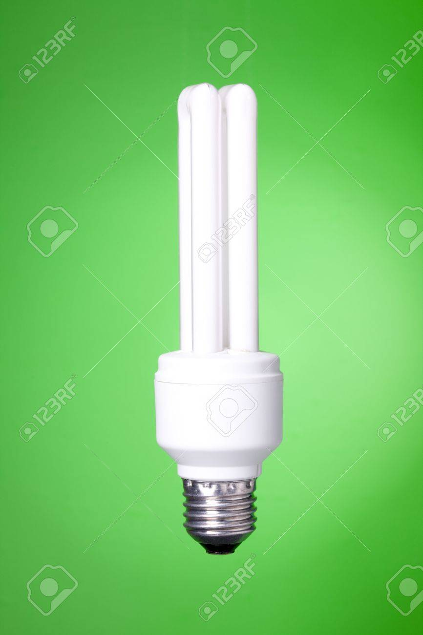 Energy saving lamp on green gradient background Stock Photo - 6417469