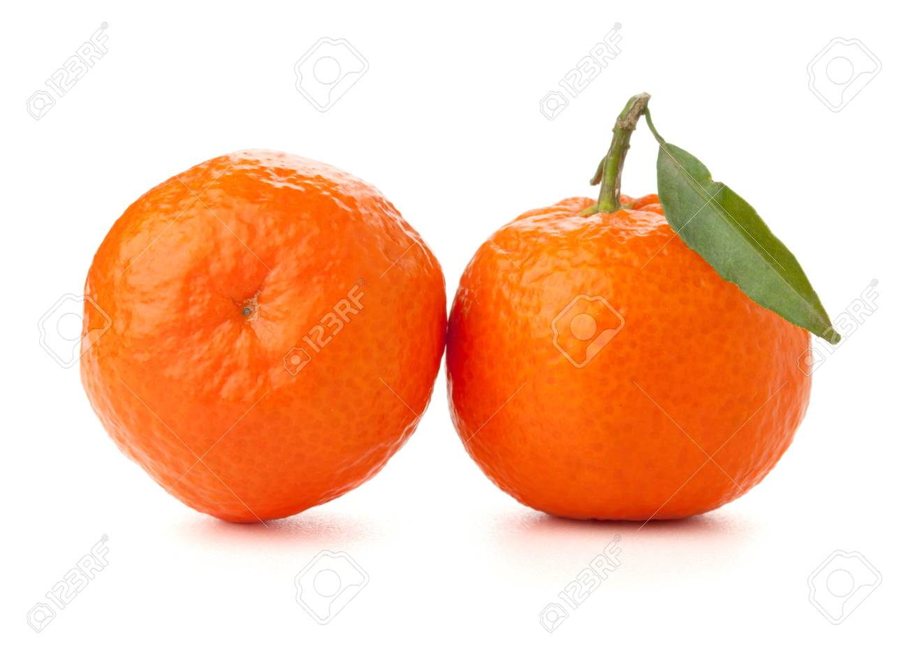 Two ripe tangerines with leafs. Isolated on white Stock Photo - 8472854