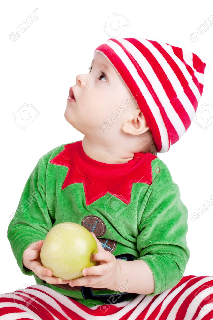 Small baby in santa suit with apple. Closeup, isolated on white Stock Photo - 9248315