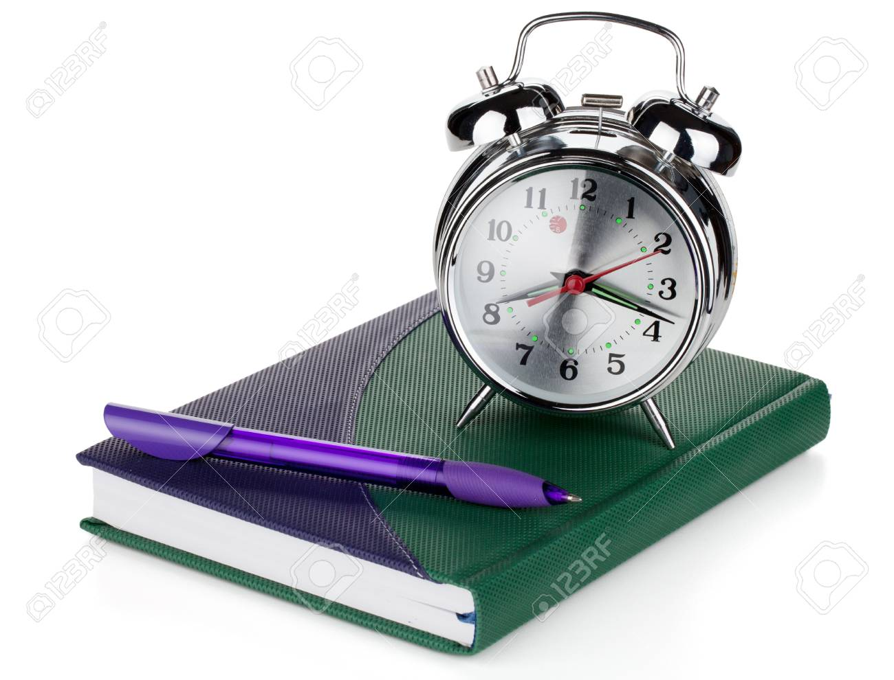 Alarm clock and pen on notepad. Isolated on white background Stock Photo - 9703726
