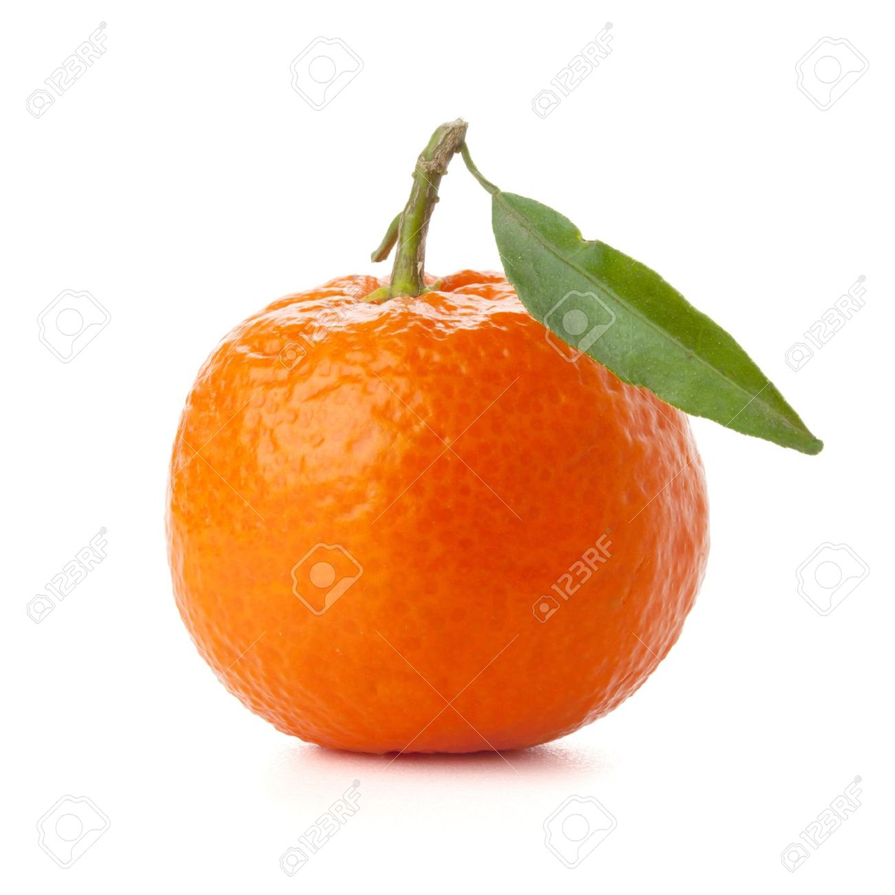 Ripe tangerine with green leaf. Isolated on white - 9797452