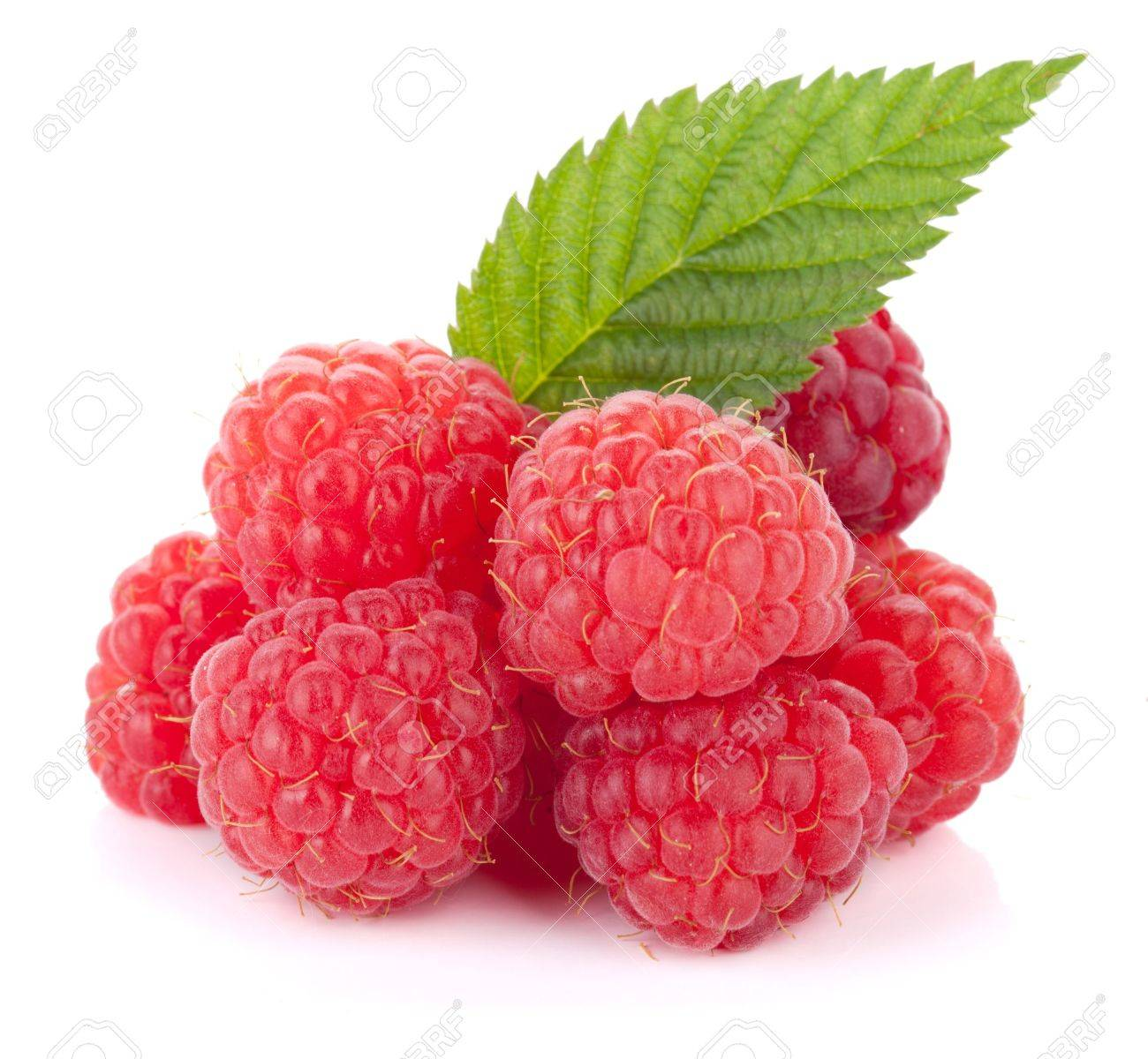 Fresh raspberries with green leaf. Isolated on white background Stock Photo - 10066718