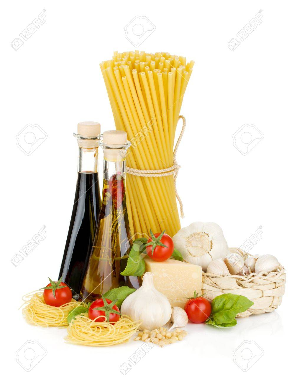 Pasta, tomatoes, basil, olive oil, vinegar, garlic and parmesan cheese. Isolated on white background Stock Photo - 12780199