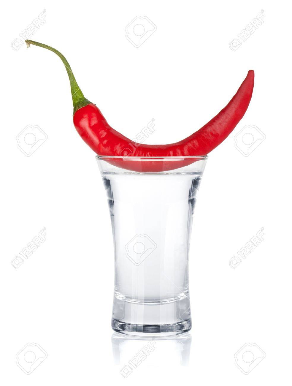 Shot of vodka and red hot chili pepper  Isolated on white background Stock Photo - 16660800