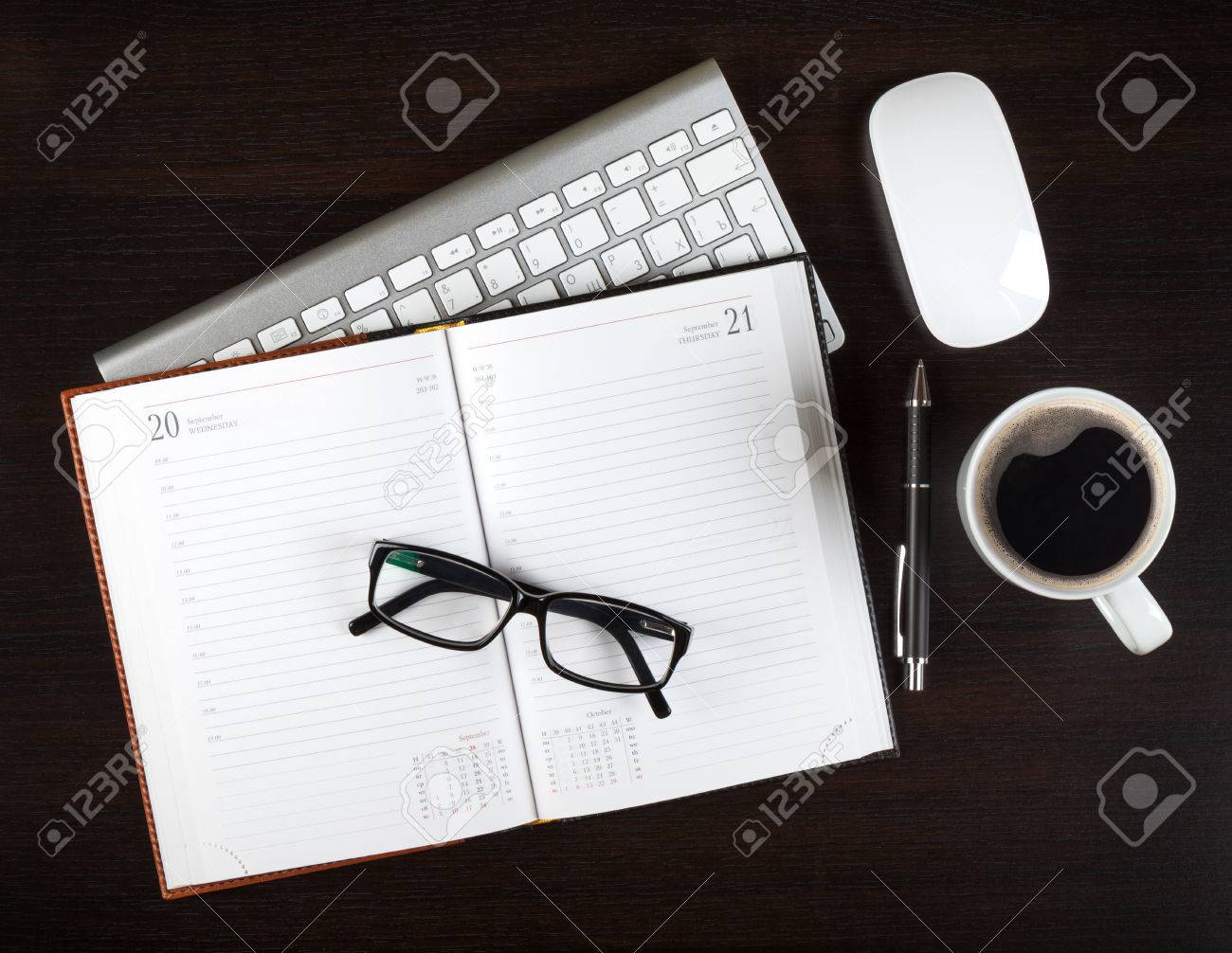 Blank notepad and coffee cup on office wooden table Stock Photo - 22271477