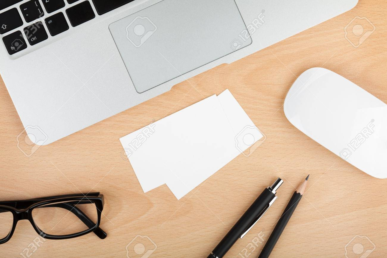 Blank business cards with supplies on wooden office table Stock Photo - 22568170