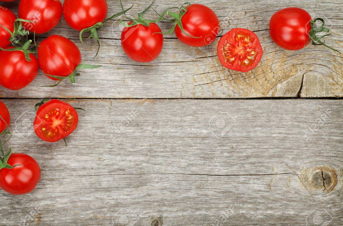 Image result for tomatoes on the wooden table