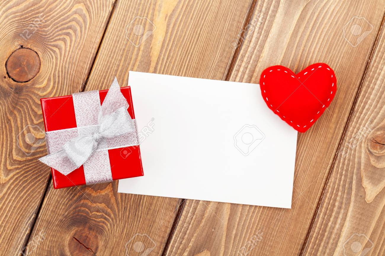 Photo Frame Or Greeting Card With Gift Box And Toy Heart Over