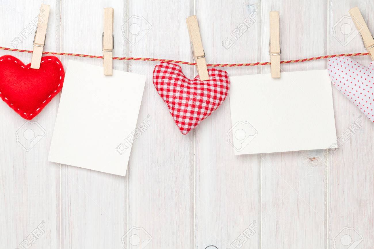 Photo Frames And Valentines Toy Hearts Over Wooden Background Stock ...
