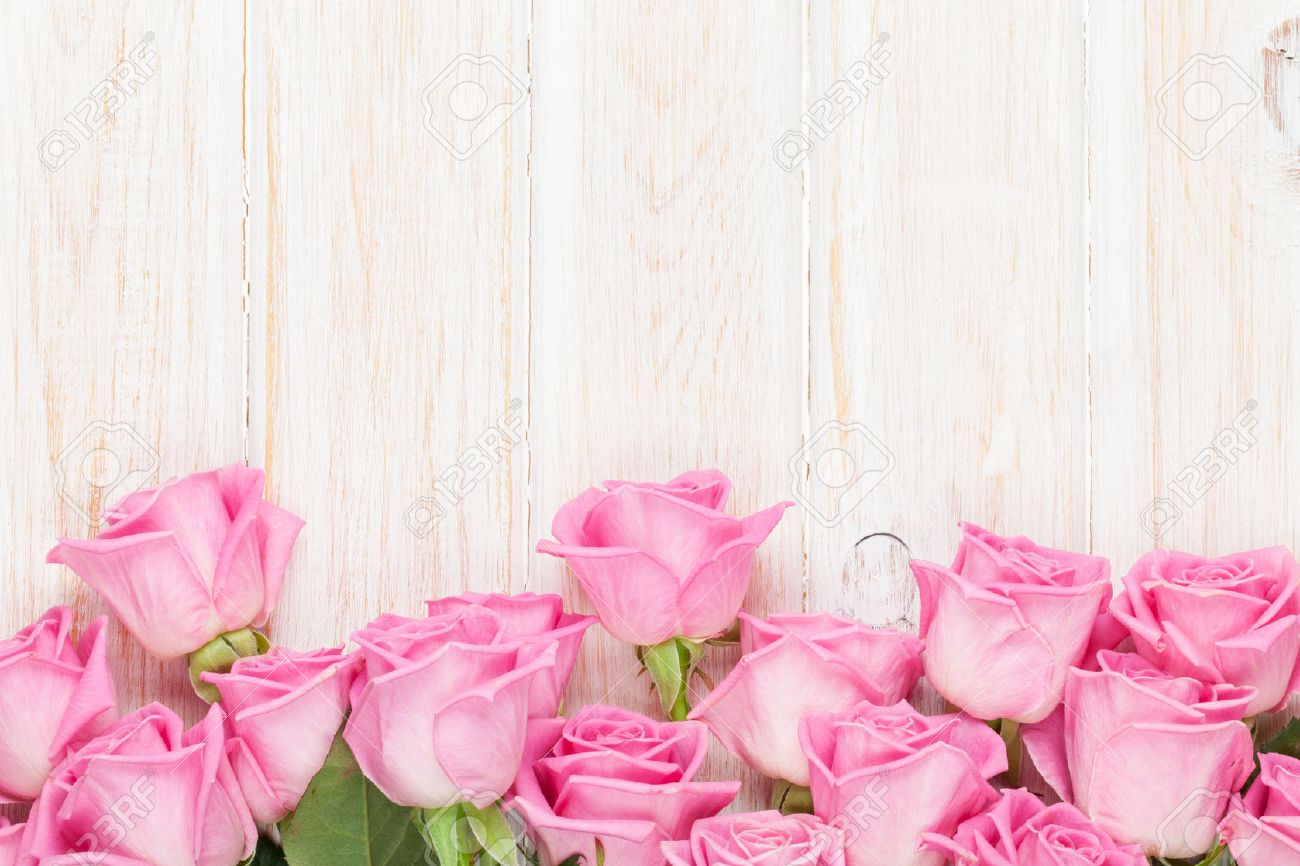 Valentines Day Background With Pink Roses Over Wooden Table. Top View With  Copy Space Stock