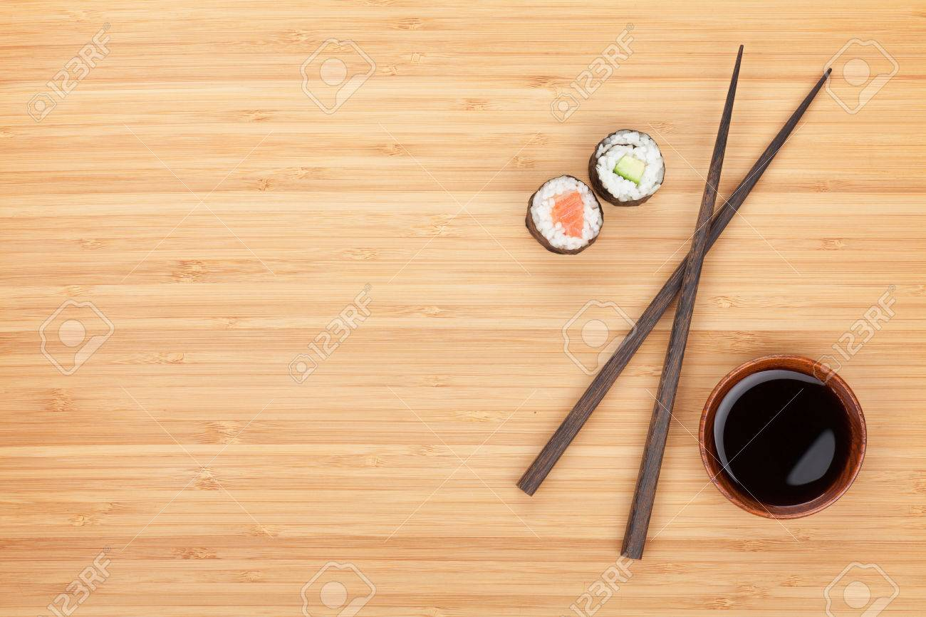 Maki Sushi, Chopsticks And Soy Sauce On Bamboo Wooden Table Background With  Copy Space Stock