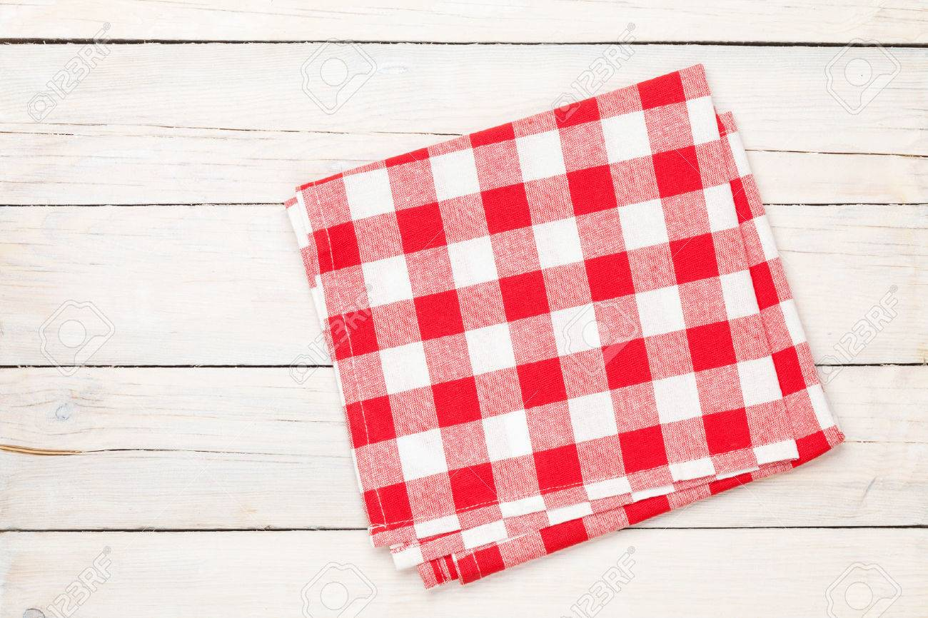 Red Towel Over Wooden Kitchen Table. View From Above With Copy Space Stock  Photo