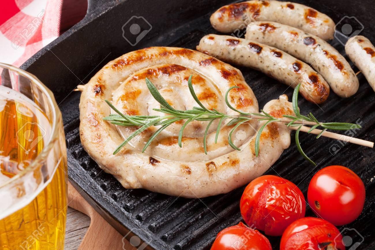 Grilled sausages and beer mug - 42663281