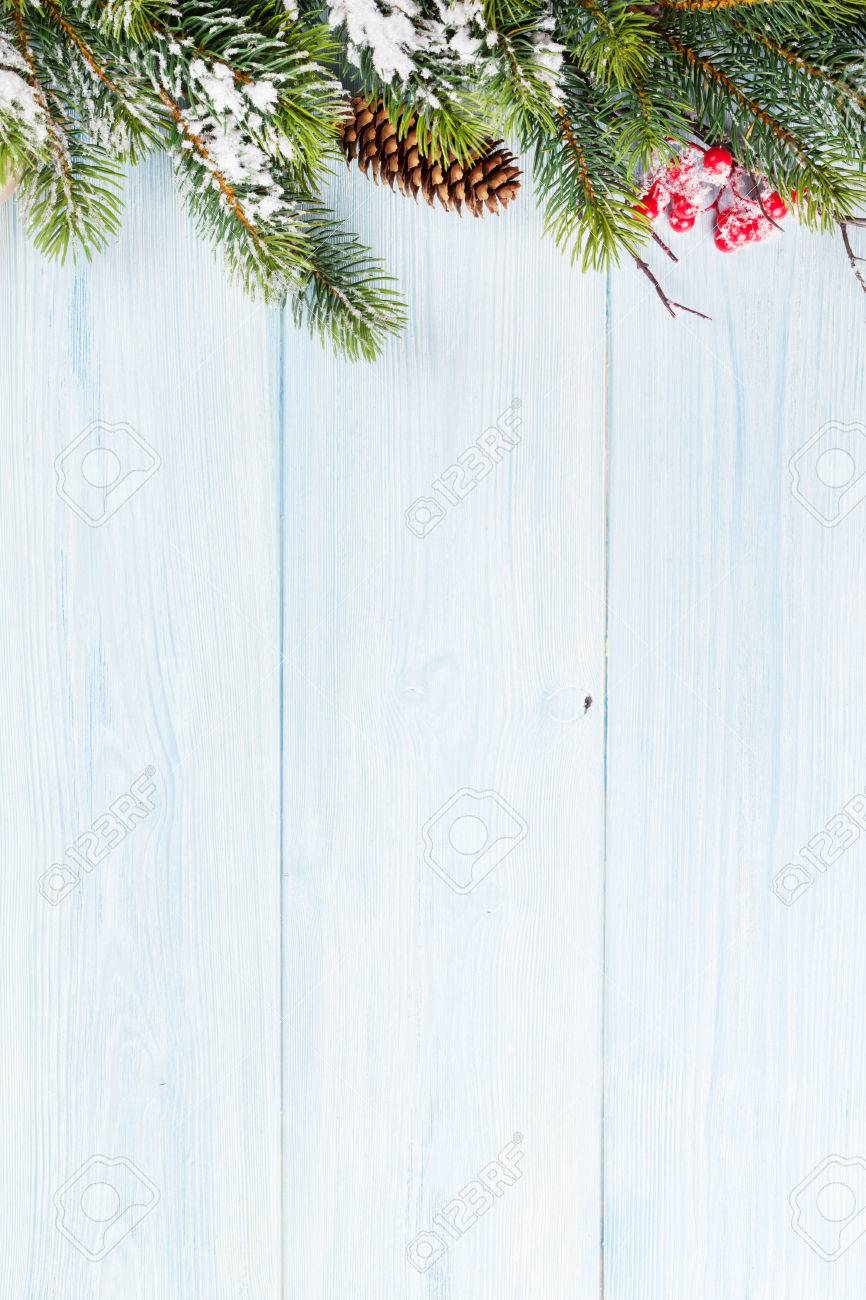 Christmas wooden background with snow fir tree  View with copy