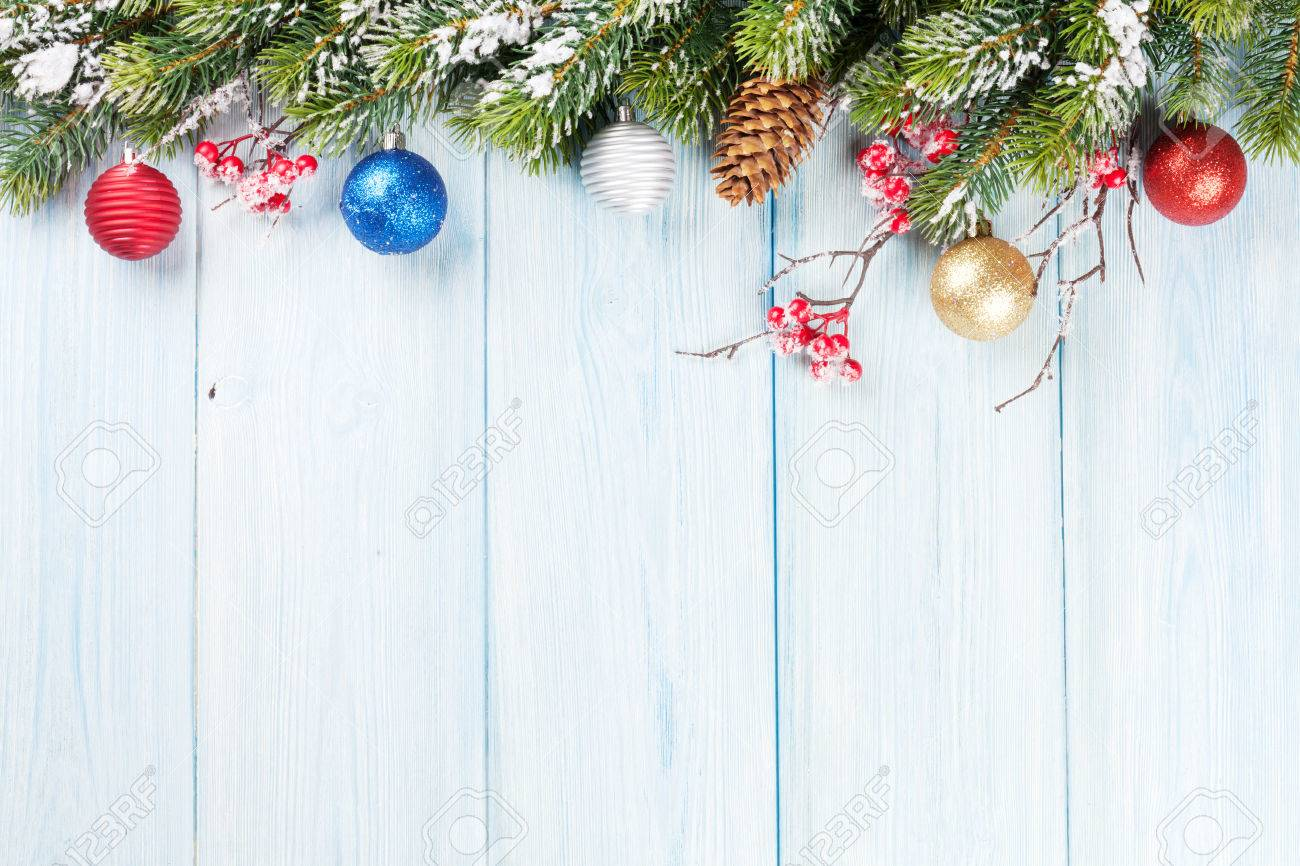 Christmas wooden background with snow fir tree and decor  View