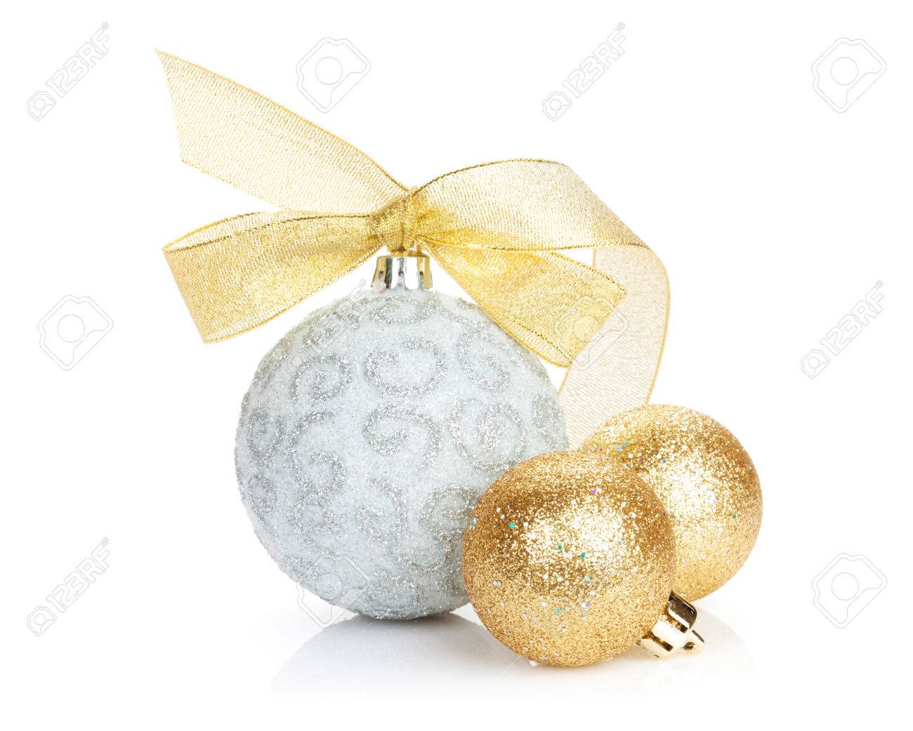 Christmas baubles and golden ribbon. Isolated on white background - 46103575
