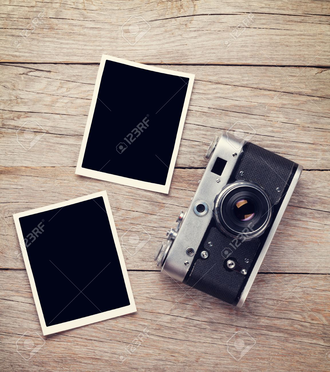 Vintage Film Camera And Two Blank Photo Frames On Wooden Table ...