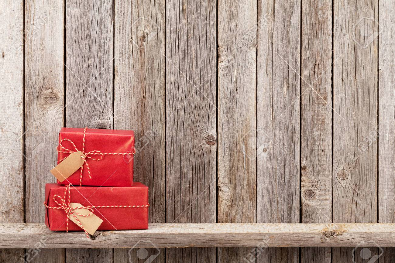 Christmas gift boxes in front of wooden wall. View with copy space Stock Photo - 48499919