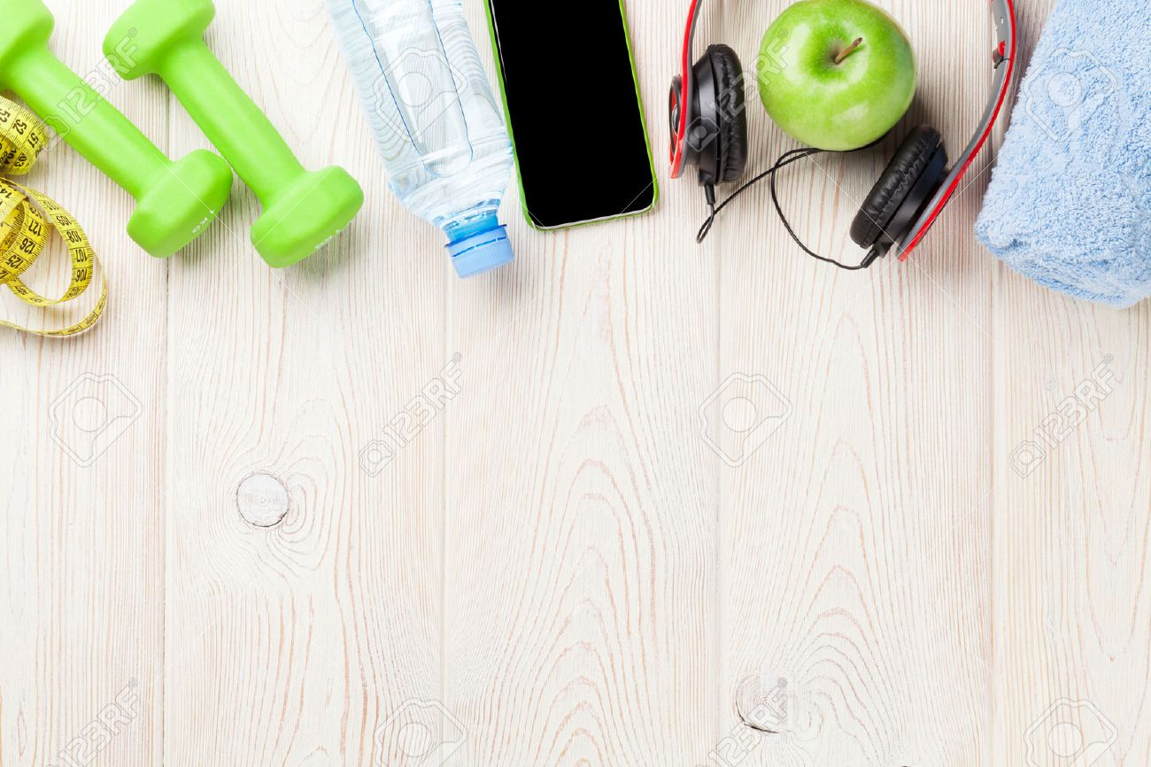 Dumbbells, water bottle, smartphone, headphones and tape measure. Fitness concept. Top view with copy space - 51156550
