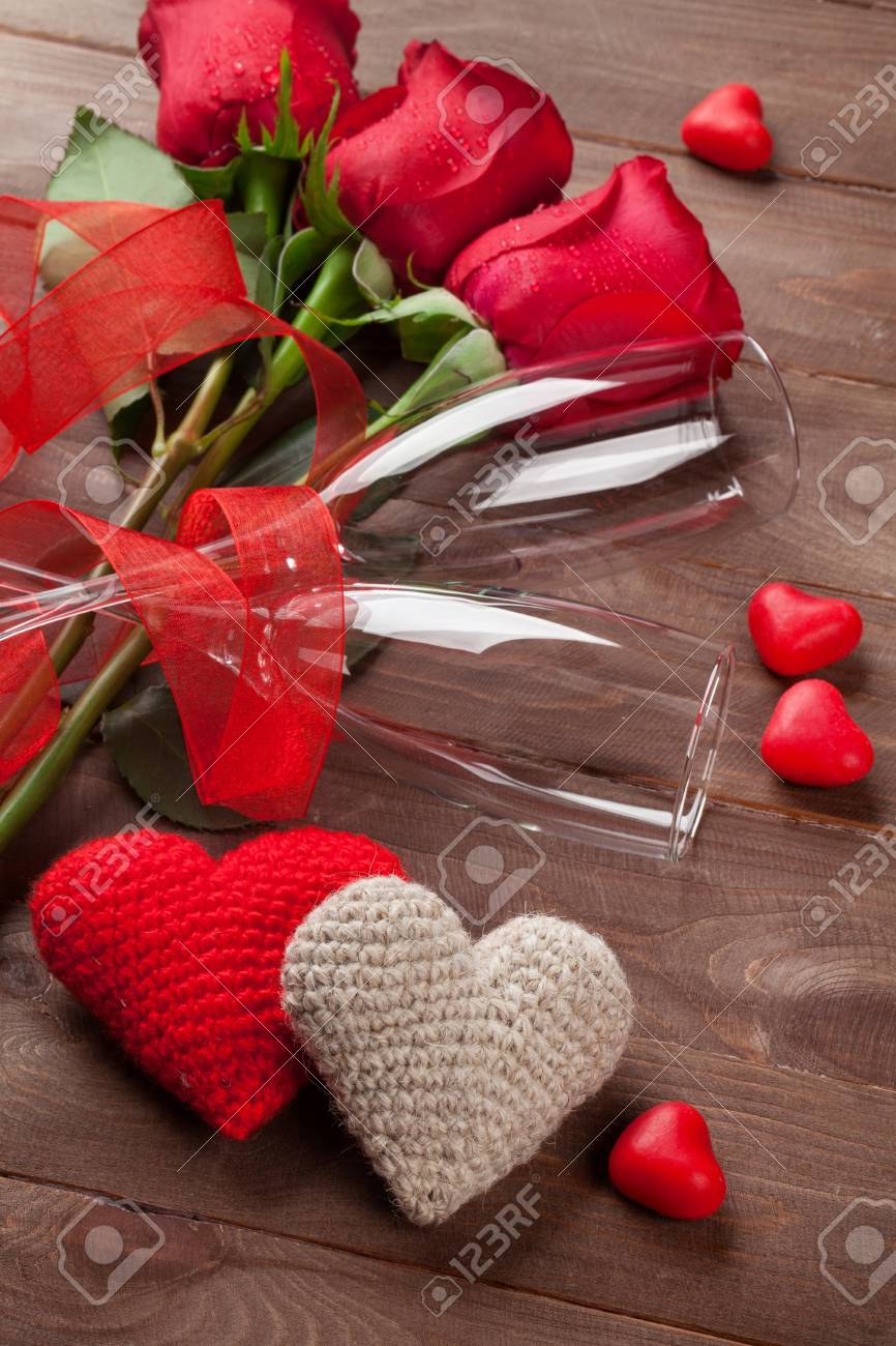 Red Roses Hearts And Champagne Glasses Over Wood Valentines