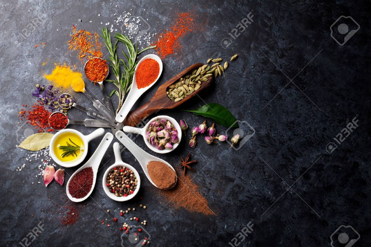 Herbs and spices over black stone background. Top view with copy space - 51528610