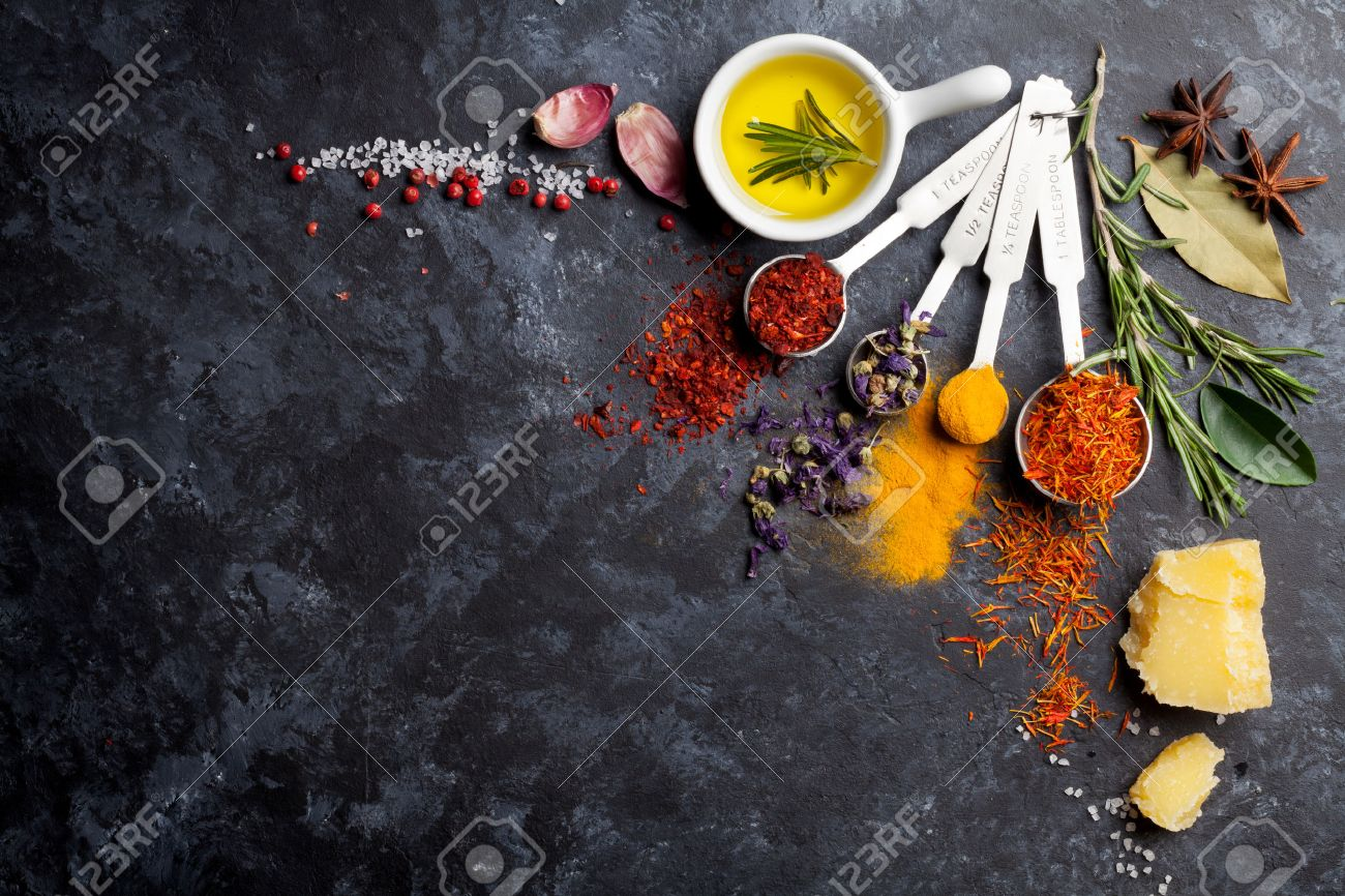 Herbs and spices over black stone background. Top view with copy space - 51528616