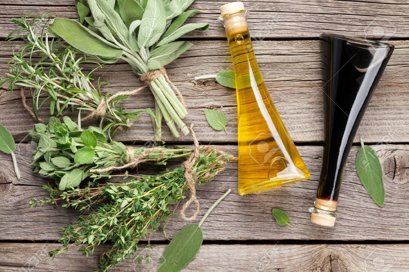 Fresh garden herbs and condiments on wooden table. Top view - 52148477