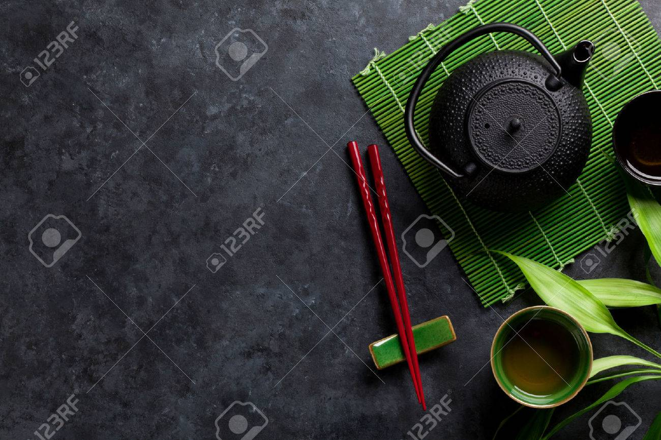 Green tea and sushi chopsticks on stone table. Top view with copy space - 52586466