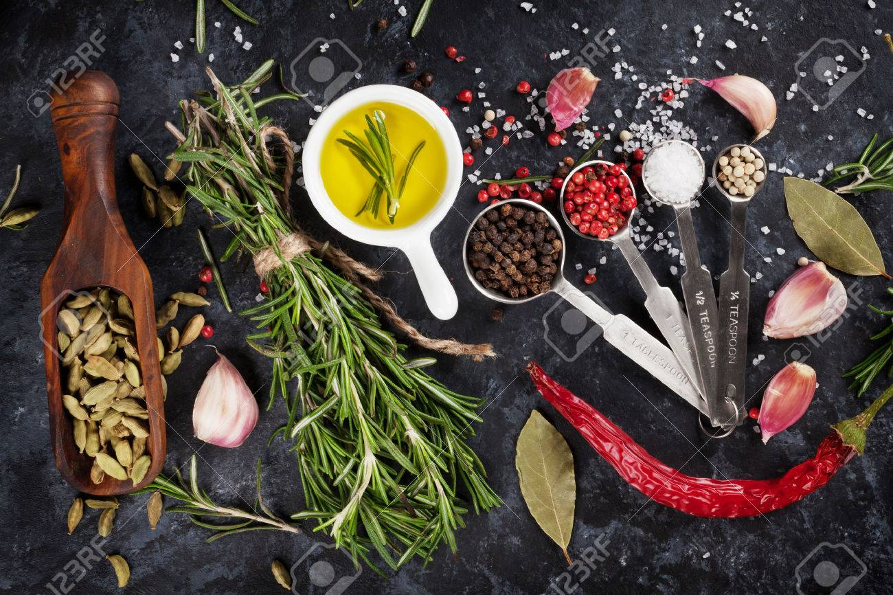 Herbs and spices over black stone background. Top view - 52796676