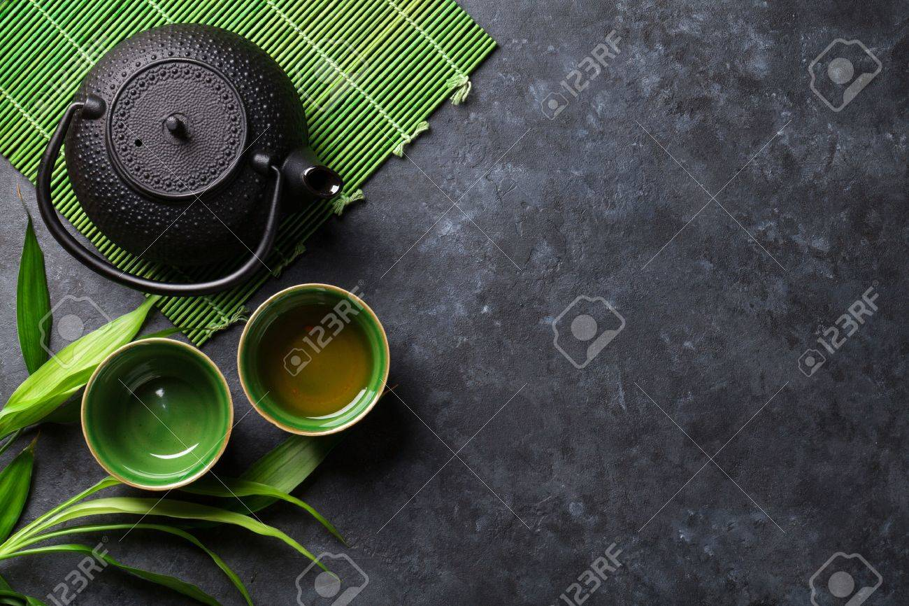 Green japanese tea on stone table. Top view with copy space - 55956412
