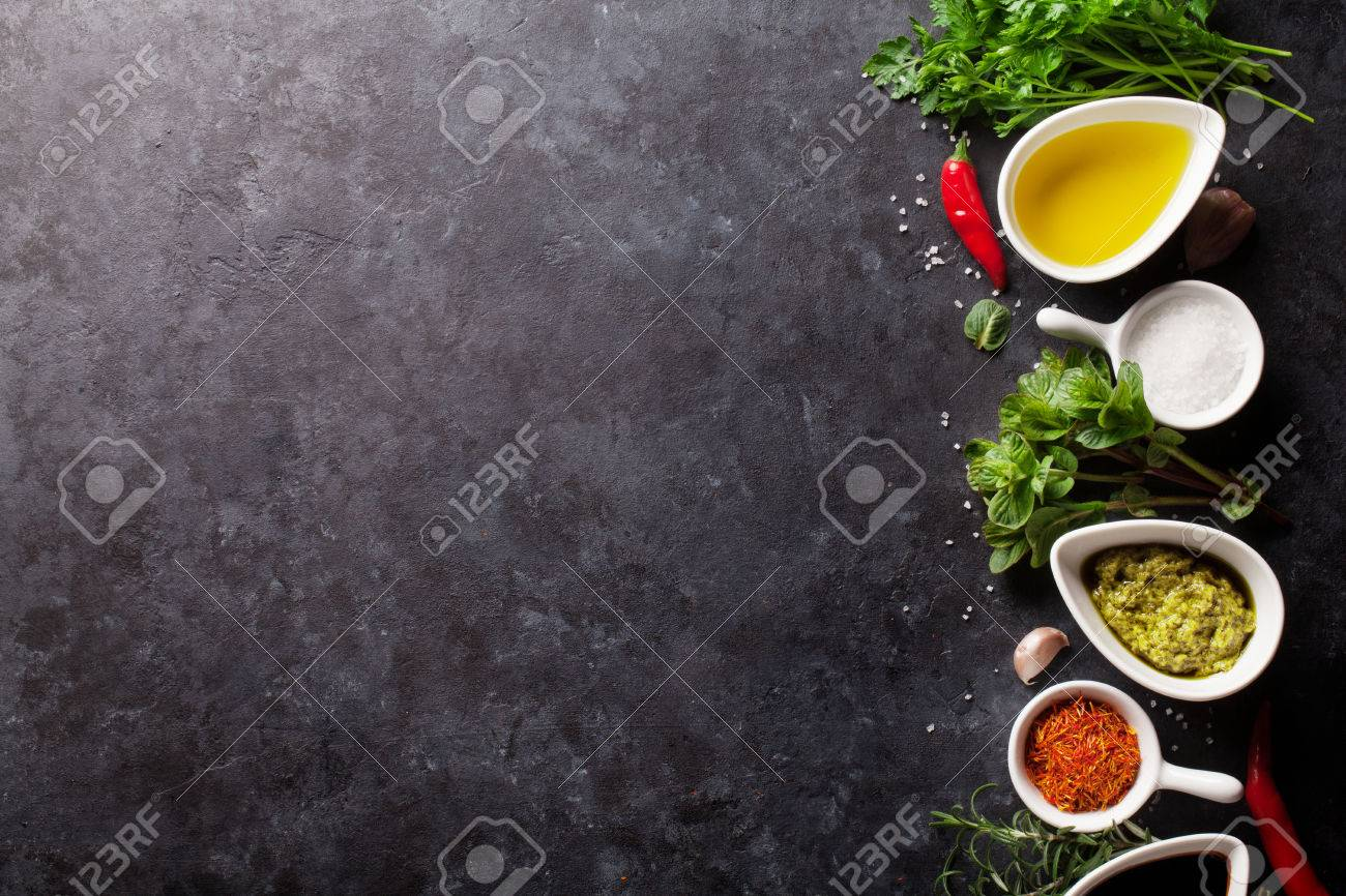 Herbs, condiments and spices on stone background. Top view with copy space Standard-Bild - 55955453