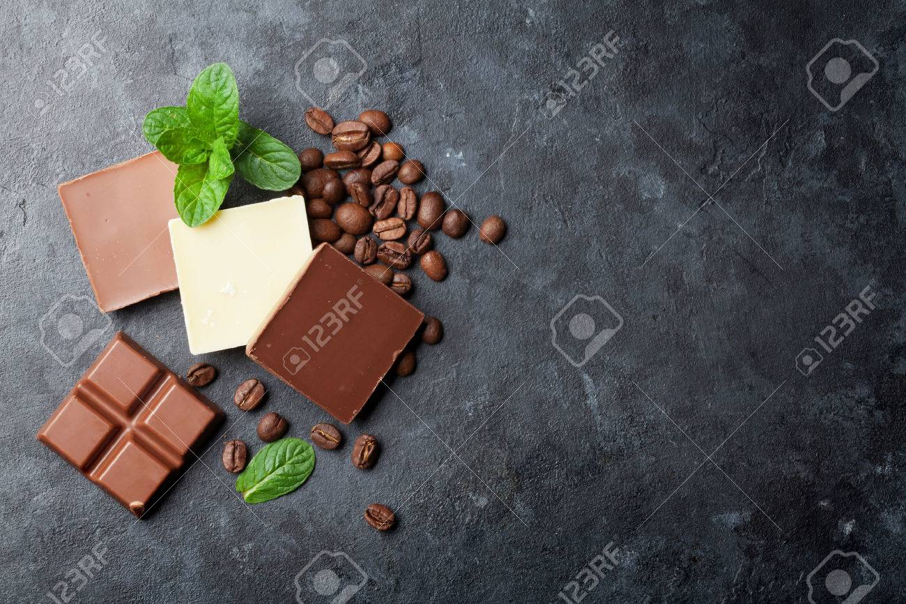 Chocolate and coffee beans on dark stone table. Top view with copy space Standard-Bild - 56448106