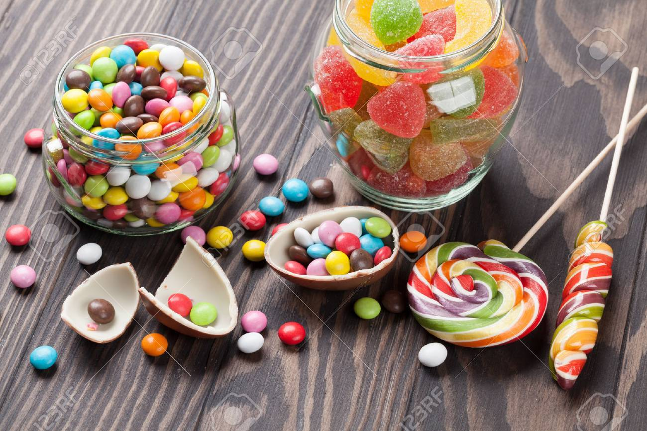 Colorful candies on wooden table background - 57081536