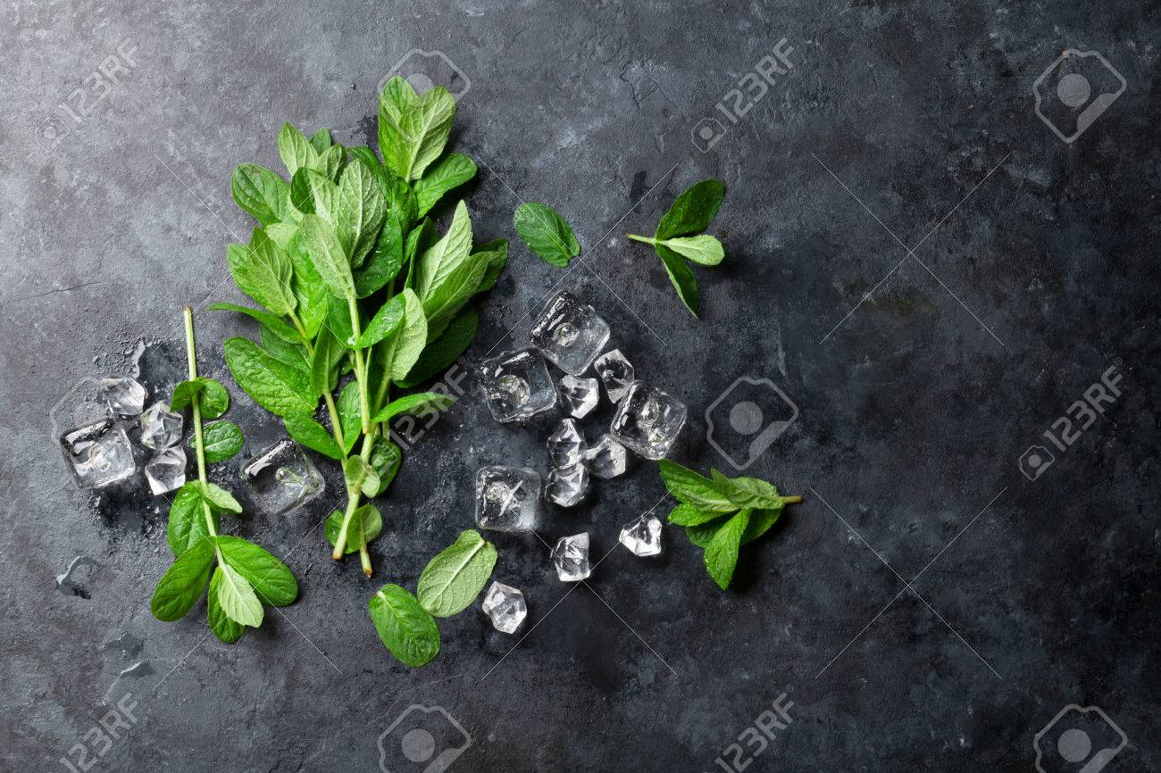 Mint and ice on stone table. Top view with copy space Standard-Bild - 57787953