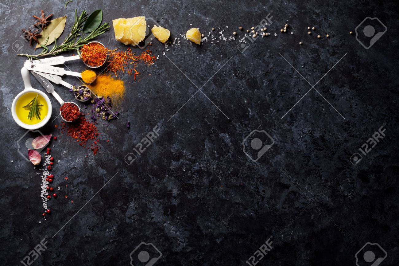 Herbs and spices over black stone background. Top view with copy space Standard-Bild - 58872226