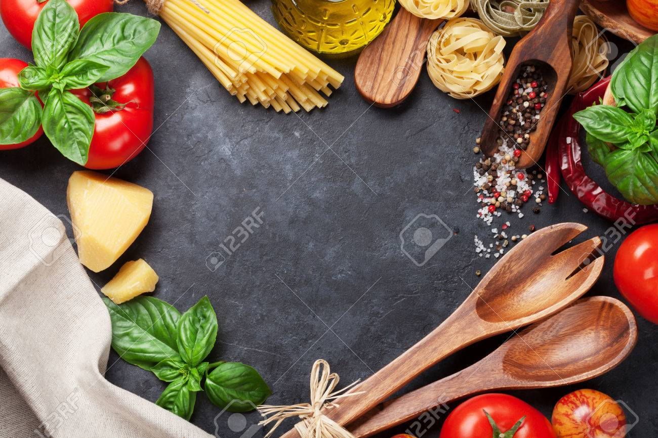 Italian food cooking. Tomatoes, basil, spaghetti pasta, olive oil and chili pepper on stone kitchen table. Top view with copy space for your recipe Standard-Bild - 59668228