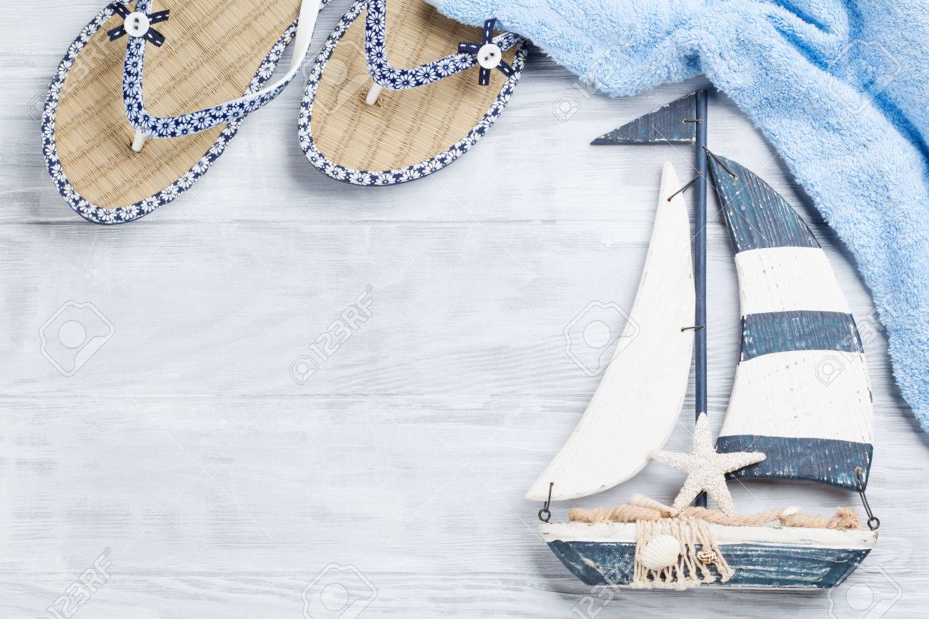 Beach Accessories Flip Flops Towel And Boat Decor On Wooden
