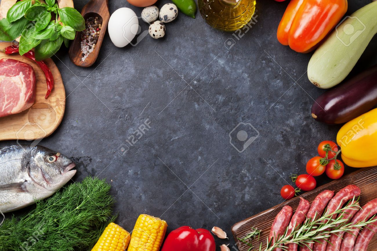 Vegetables, fish, meat and ingredients cooking. Tomatoes, eggplants, corn, beef, eggs. Top view with copy space on stone table Standard-Bild - 62201946