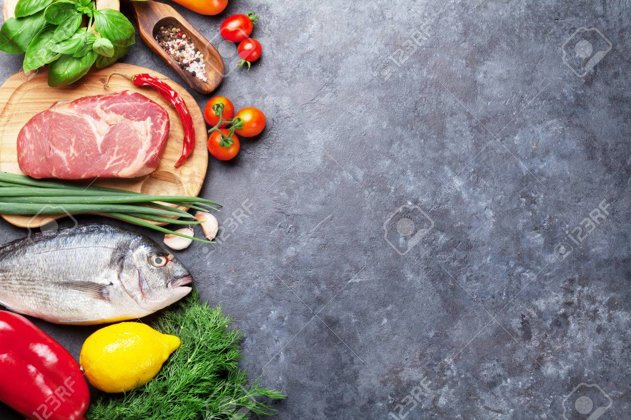 Vegetables, fish, meat and ingredients for cooking. Tomatoes, pepper, corn, beef, eggs. Top view with copy space on stone table Standard-Bild - 62201911
