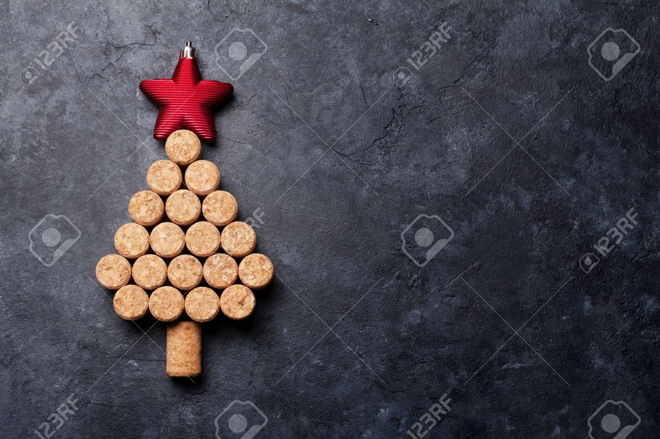Wine corks shaped christmas tree on stone table. Top view with copy space for your text - 64456912