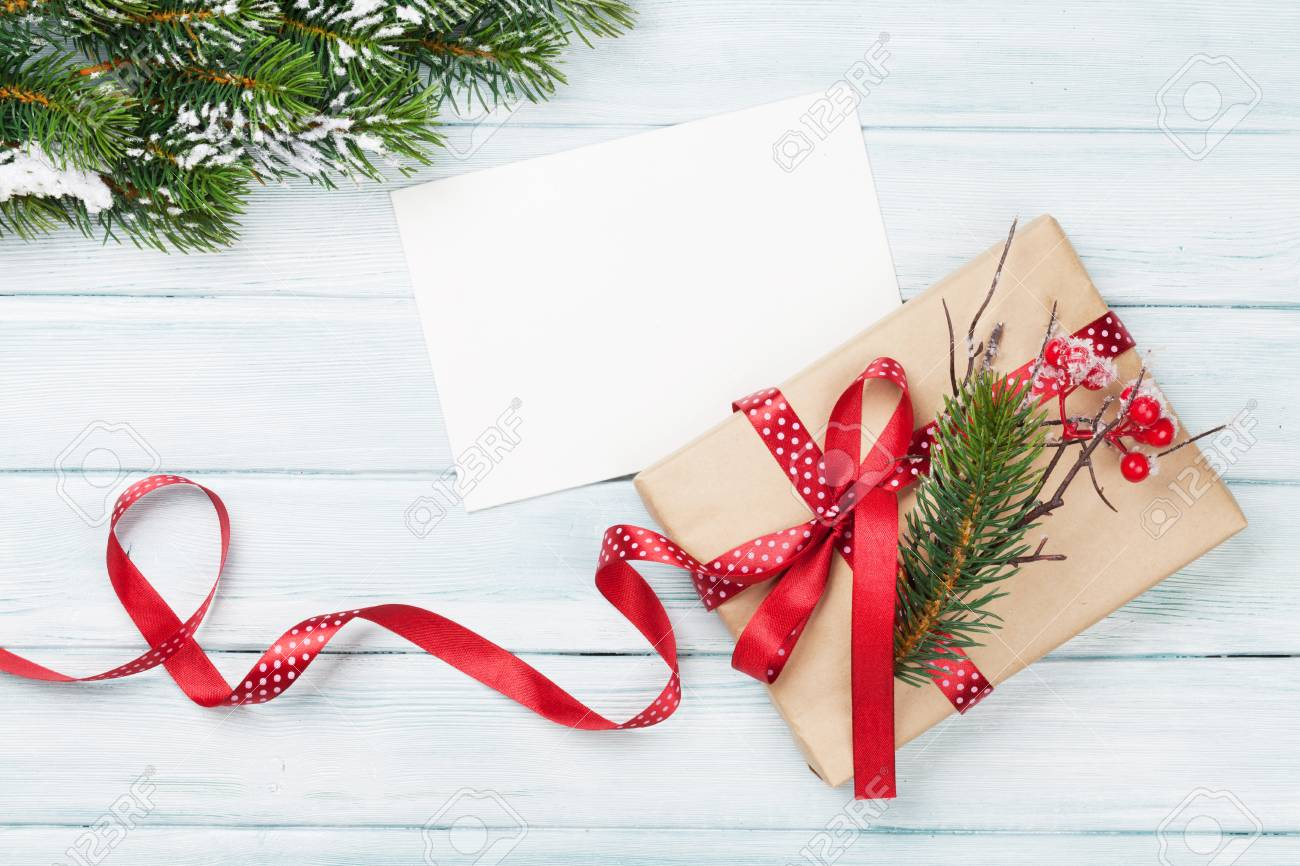 Christmas Gift.Christmas Gift Box And Greeting Card On Wooden Background Top