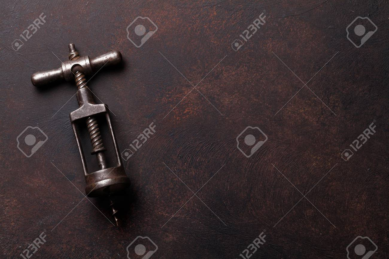 Vintage corkscrew on stone table. Top view with copy space - 128176824