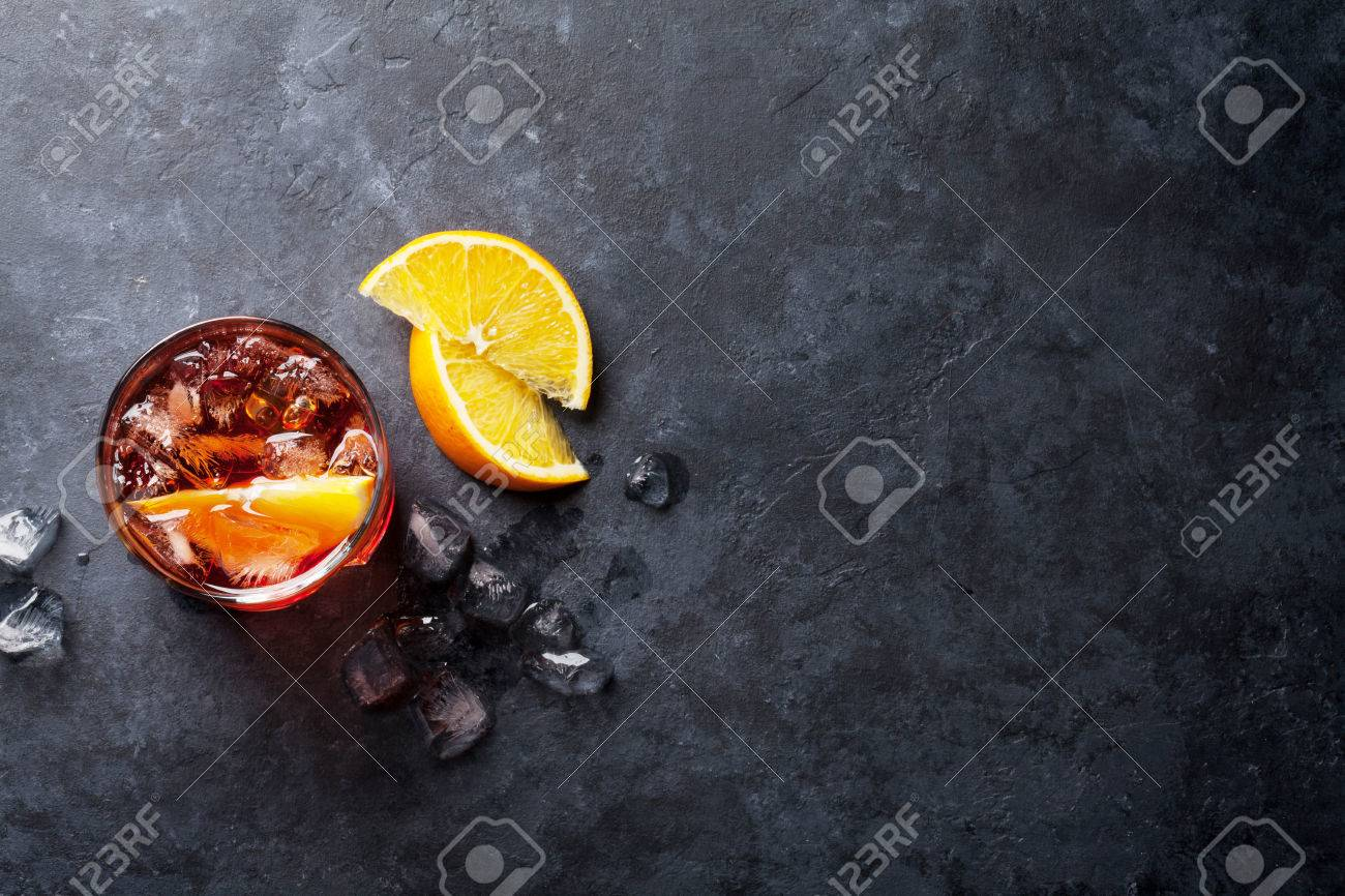 Negroni cocktail on dark stone table. Top view with space for your text Standard-Bild - 68747646