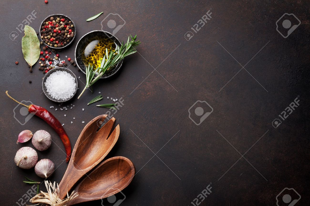 Cooking table with herbs, spices and utensils. Top view with copy space Standard-Bild - 69598658