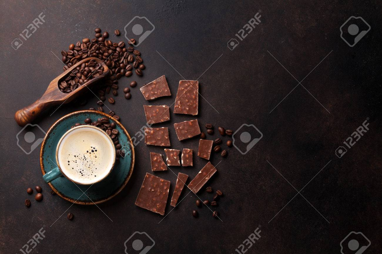 Coffee cup, beans and chocolate on old kitchen table. Top view with copyspace for your text - 75270851