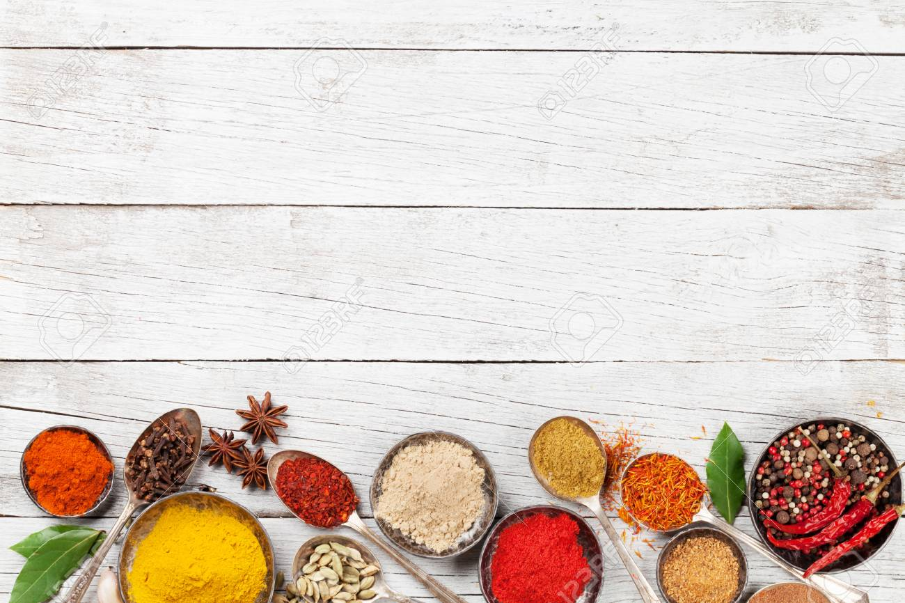 Various spices and herbs on wooden table. Top view with space for your text - 83980252