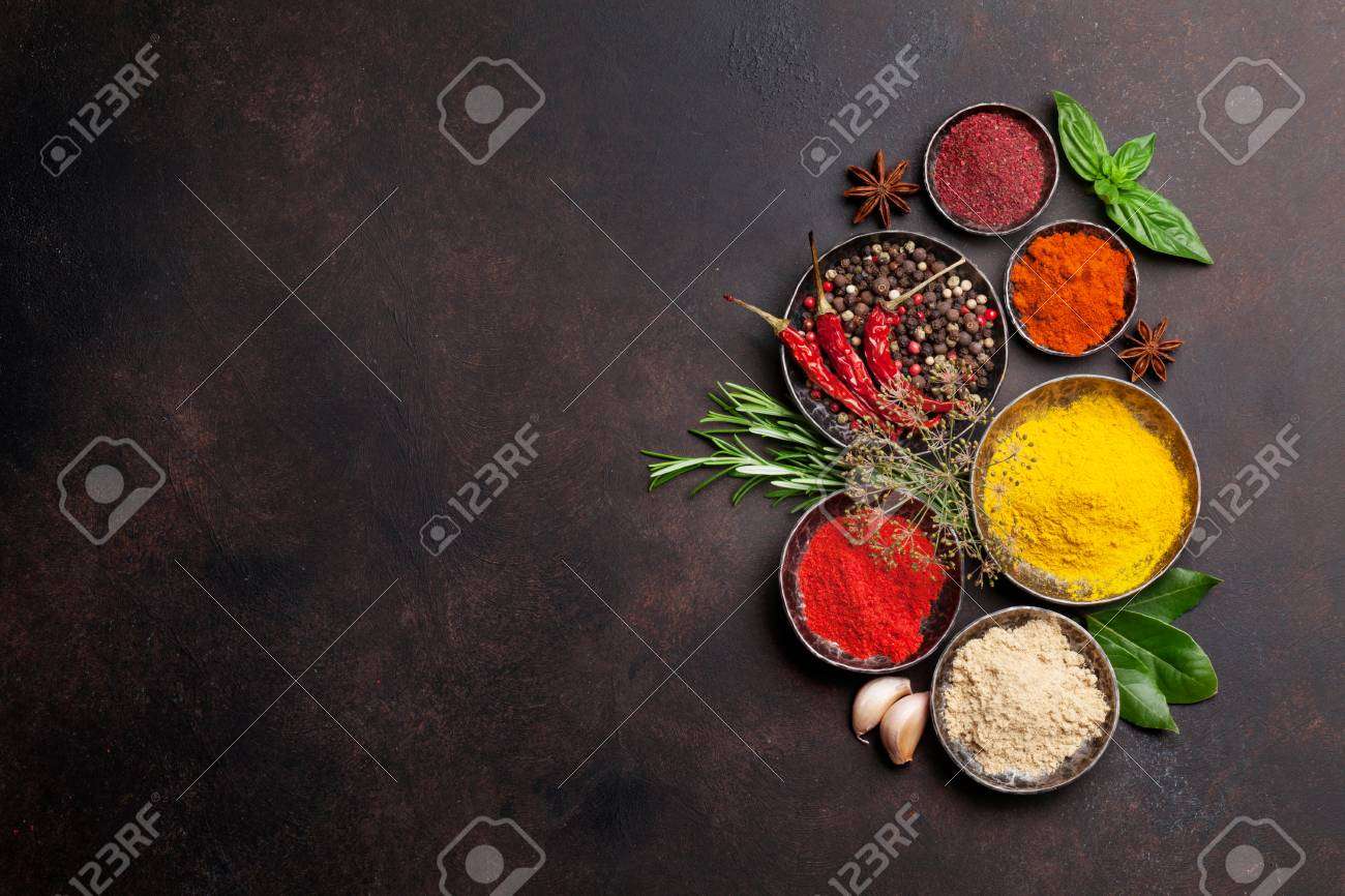 Various spices and herbs on stone table. Top view with space for your text - 84710760